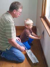 Painting with a young helper